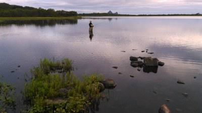 Juha is fly fishing.