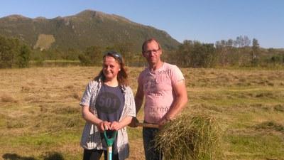Tiu and Markus shuffeling hay.